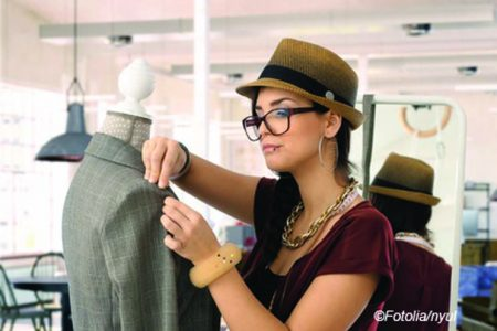 Small business - fashion designer young woman working in workshop